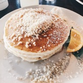 OH MY GOD macademia nut pancakes topped with coconut syrup?? YES PLEASE